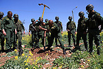 Palestinian security officers plant trees during an event marking Land Day, near the West Bank city of Nablus, Wednesday, March 30, 2011. Land Day commemorates the killing of six Arab citizens of Israel by the Israelis on March 30, 1976 during protests over confiscations of Arab land.Photo by Wagdi Eshtayah