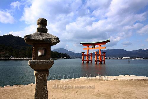 Jan. 24, 2009; Miyajima, Japan - Tori gate and Japanese stone lantern...Miyajima is one of Japan's three most beautiful sights to see.