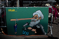 A banner with the face of their Iranian leader Hassan Rouhani is seen during a protest against U.N. near their headquarters in New York,  Sept 24, 2013, Photo by Stringer / VIEWpress.