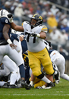 STATE COLLEGE, PA - OCTOBER 27: Iowa T Alaric Jackson (77) blocks on a running play. The Penn State Nittany Lions defeated the Iowa Hawkeyes 30-24 on October 27, 2018 at Beaver Stadium in State College, PA. (Photo by Randy Litzinger/Icon Sportswire)