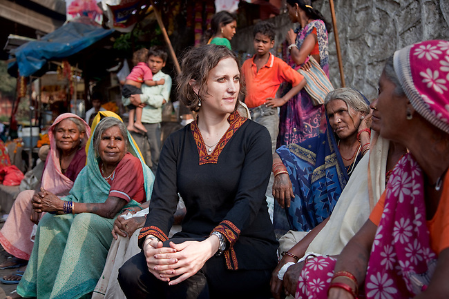 25 October 2011, New Delhi, INDIA:  Dr Anna Stratis, Chief Medical Officer with World Health Partners speaks to local women in the Delhi suburb of Karol Bagh beneath a giant statue of the monkey god Hanuman. Dr Stratis is involved in a program that aims to bring modern diagnostic technology to rural India to combat prevalent illness such as Tuberculosis.  Picture by Graham Crouch/The Toronto Star