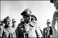 BNPS.co.uk (01202 558833)Pic:    Pen&Sword/BNPS<br /> <br /> A famous image of General Rommel speaking to German and Italian commanders in the field.<br /> <br /> Fascinating rare photos of Rommel's feared Afrika Korps which terrorised the Allies in the desert have come to light in a new book.<br /> <br /> Under the direction of legendary German commander Field Marshal Erwin Rommel, who was nicknamed the Desert Fox, the corps were recognised as a superb fighting machine.<br /> <br /> They achieved their greatest triumph when they outmanoeuvred the British at the Battle of Gazala in June 1942 which led to them capturing Tobruk in Libya.<br /> <br /> But they were ultimately defeated in the iconic Battle of Alamein when they succumbed to an offensive led by Field Marshal Bernard Montgomery.