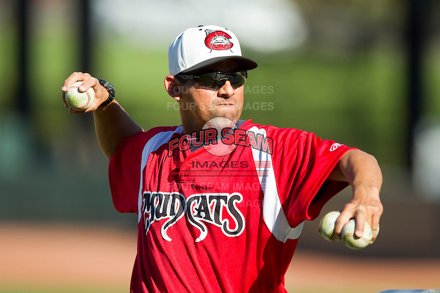 Carolina Mudcats hitting coach Rouglas Odor (24) throws batting practice prior to the game against the Winston-Salem Dash at BB&T Ballpark on April 13, 2013 in Winston-Salem, North Carolina.  The Dash defeated the Mudcats 4-1.  (Brian Westerholt/Four Seam Images)