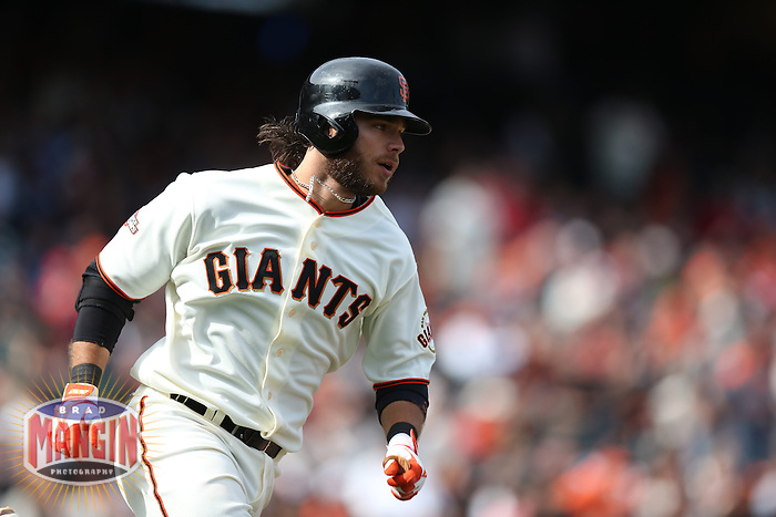 SAN FRANCISCO, CA - APRIL 6:  Brandon Crawford #35 of the San Francisco Giants runs to first base during the game against the St. Louis Cardinals on Saturday, April 6, 2013 at AT&T Park in San Francisco, California. Photo by Brad Mangin