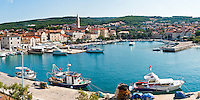 Panoramic photo of Supetar Harbor and the Church of the Annunciation, Brac Island, Dalmatian Coast, Croatia. This is a panoramic photo of Supetar Harbor and the Church of the Annunciation on Brac Island. Although Supetar is less visited than Bol Town on the other side of Brac Island, it is a brilliant holiday destination and host to traditional, beautiful Croatian architecture. The highlight of Supetar is without doubt the Church of the Annunciation, whose church spire can be seen from the whole of the Supetar harbor and town.