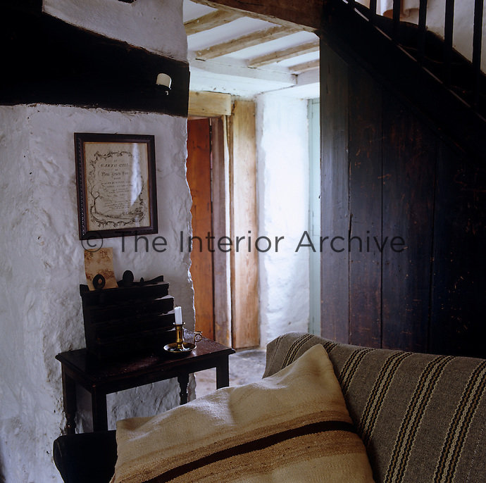 Looking over the sofa towards the entrance hall little has changed since the house was built in 1805