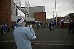 A souvenir seller holding Christmas-themed hats outside Ewood Park, home of Blackburn Rovers, before the club played host to Aston Villa in a Barclays Premier League match. Blackburn won the match by two goals to nil watched by a crowd of 21,848. It was Rovers' first match under the ownership of Indian company Venky's.