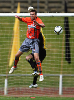 Wellington keeper Jim Bannatyne punch the ball away from Mike Gwyhter..NZFC soccer  - Team Wellington v Waikato FC at Newtown Park, Wellington. Sunday, 20 December 2009. Photo: Dave Lintott/lintottphoto.co.nz