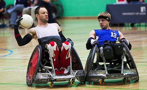 15 AUG 2011 - LEEDS, GBR - Canada's Fabien Lavoie (left) attempts  to avoid a challenge from Great Britain's Aaron Phipps during a wheelchair rugby warmup match between the two teams .(PHOTO (C) NIGEL FARROW)