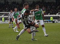 Matthew Doherty goes in hard on Dougie Imrie in the St Mirren v Hibernian Clydesdale Bank Scottish Premier League match played at St Mirren Park, Paisley on 29.4.12.