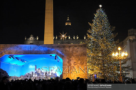 Christmas tree,nativity crib in Saint Peter's Square;Pope Benedict XVI celebrates the midndight Christmas mass at St. Peter's Basilica in Vatican City on December 24, 2012
