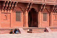 Fatehpur Sikri, Uttar Pradesh, India.  Women Talking in front of Diwan-i-Khas, the Emperor Akbar's Hall of Private Audience.