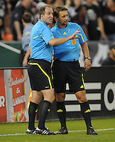 MLS referee Alex Prus consults with referee's assistant Adam Wienckowski before giving Jaime Moreno an Brandon McDonald a red card.  San Jose Earthquakes defeated DC United 2-0 at RFK Stadium, October 9, 2010.