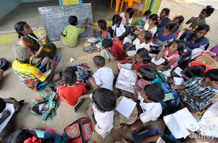 Children study in an after-school tutoring program in Poonthandalam, a village in the southern India state of Tamil Nadu.