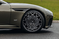 "BNPS.co.uk (01202 558833)<br /> Pic: SilverstoneAuctions/BNPS<br /> <br /> Unique 21"" OHMSS wheels.<br /> <br /> Stunning Aston Martin 'James Bond' supercar with only 45 miles on the clock - yours for £300,000.<br /> <br /> A limited edition Aston Martin that was built to mark the 50th anniversary of one of the most popular James Bond movies has emerged for sale for around £300,000.<br /> <br /> The DBS Superleggera was one of just 50 created last year to commemorate five decades since the release of On Her Majesty's Secret Service.<br /> <br /> The movie, which came out in 1969, was the first in the franchise not to feature Sean Connery and instead starred George Lazenby as 007."