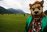 A supporter wearing a lion head stands next to the traing pitch where the Cameroon's fotball nationla team attends a training session in Walchsee, Austria on May 28, 2014 ahead of a friendly football match against Germany, on June 1, 2014 in preparation for the FIFA World Cup 2014. <br /> &copy; Pierre Teyssot
