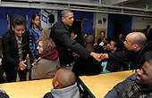 United States President Barack Obama (C), first lady Michelle Obama (L) and daughter Malia greet volunteers as they participate in a service project, at Browne Education Center, in Washington, DC, USA, on the Martin Luther King Jr national holiday, 16 January 2012. The project was in memory of the legacy of community service, promoted by the late civil rights leader, who was assassinated in 1968..Credit: Mike Theiler / Pool via CNP