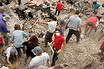 Friends, volunteers ,and neighbors gather to help a family look for personal items in the rubble of their home. Their home was in a Rancho Bernardo cul-de-sac where only 2 of 9 homes remains standing after the Witch Creek fire swept through the neighborhood during the 2007 California wildfires.