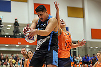 NZ Men's Junior Levi collects the ball ahead of All Stars Sulu Fitzpatrick during the Cadbury Netball Series match between NZ Men and All Stars at the Bruce Pullman Arena in Papakura, New Zealand on Friday, 28 June 2019. Photo: Dave Lintott / lintottphoto.co.nz