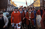 Haxey Hood Game. Haxey Lincolnshire 1970s. The Fool Peter Bee, Chief Boggin Arthur Clark  and Lord Stan Boor. <br /> <br /> Chief Boggin holding the Hood and the Lord with 'wand 'of office.