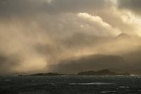 Mountains emerge from autumn storm, Lofoten Islands, Norway