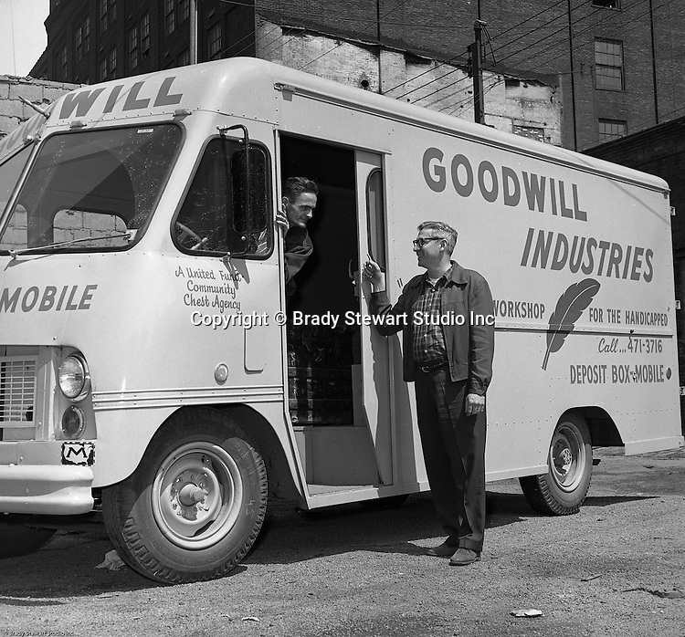 Pittsburgh PA:  View of driver getting ready to go out to pick up donations at the Goodwill drop off boxes - 1966. <br /> In 1966, Goodwill Industries was part of the United Fund Community Chest Agency which eventually became the United Way of Allegheny County in 1974. Goodwill Industries provides a broad array of employment-related education and workforce development programs and services for people with physical and intellectual disabilities and other barriers to employment.