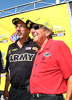 Jul 24, 2016; Morrison, CO, USA; Mike Green (left) crew chief for NHRA top fuel driver Tony Schumacher (not pictured) with team owner Don Schumacher during the Mile High Nationals at Bandimere Speedway. Mandatory Credit: Mark J. Rebilas-USA TODAY Sports
