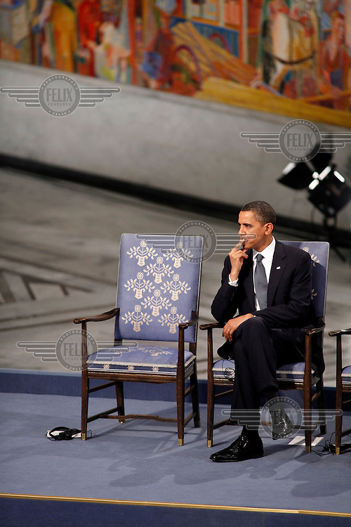 US President Barack Obama waits for the presentation of the Nobel Peace Prize during a ceremony in Oslo Town Hall.