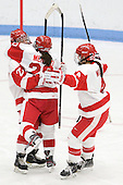Tara Watchorn (BU - 27), Isabel Menard (BU - 20), Kathryn Miller (BU - 4) - The Boston University Terriers defeated the visiting University of Connecticut Huskies 4-2 on Saturday, November 19, 2011, at Walter Brown Arena in Boston, Massachusetts.