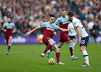 23rd November 2019; London Stadium, London, England; English Premier League Football, West Ham United versus Tottenham Hotspur; Declan Rice of West Ham United on the ball with Ben Davies of Tottenham Hotspur marking the defnder - Strictly Editorial Use Only. No use with unauthorized audio, video, data, fixture lists, club/league logos or 'live' services. Online in-match use limited to 120 images, no video emulation. No use in betting, games or single club/league/player publications