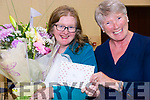 Moving on to pastures new after 7 years as Manager of Glenbeigh's Sports Hall Joan McGillicuddy is presented with flowers & a token of appreciation for her years of service by Patricia Griffin.