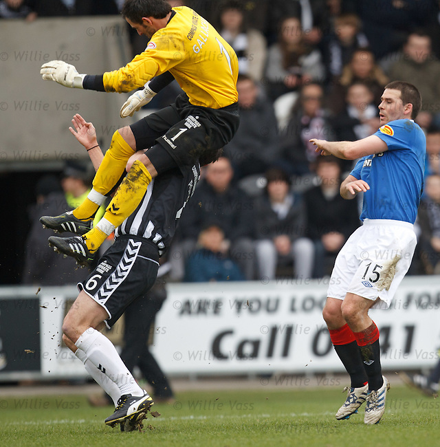 Paul Gallacher goes flying over his defender as David Healy takes cover