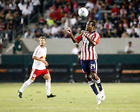 Chivas USA forward, Atiba Harris(24) goes up for a header during the 2nd half. Chivas USA  took on the NY Red Bulls on June 28, 2008 at the Home Depot Center in Carson, CA. The game ended in a 1-1 tie.