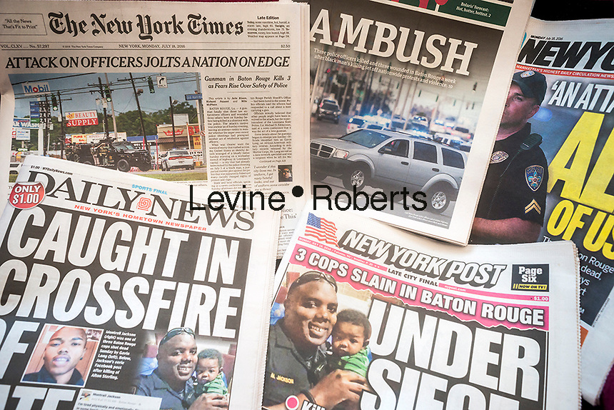 New York newspapers on Monday, July 19, 2016 report on the previous days shooting deaths of police officers in Baton Rouge, LA. (© Richard B. Levine)