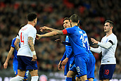 27th March 2018, Wembley Stadium, London, England; International Football Friendly, England versus Italy; Kyle Walker of England speaks out against Federico Chiesa of Italy after the referee awards a penalty