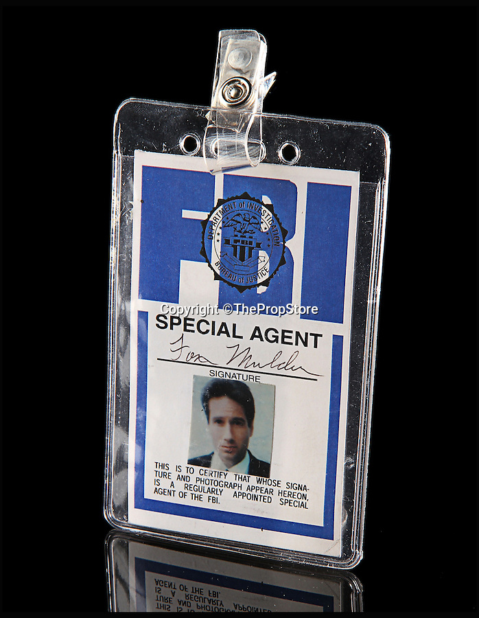 BNPS.co.uk (01202 558833)<br /> Pic: ThePropStore/BNPS<br /> <br /> David Duchovny's Fox Mulder FBI ID from The X-Files.<br /> <br /> Stop! Police! - Hollywoods finest...and funniest id badges come up for auction.<br /> <br /> The world's largest ever collection of IDs belonging to a who's who of film and TV stars is set to be auctioned. <br /> <br /> Credentials used by Hollywood royalty including Jodie Foster, Bruce Willis, Leonardo DiCaprio, Jeremy Irons, Eddie Murphy and Kiefer Sutherland are all about to go under the hammer. <br /> <br /> The lots are being sold on behalf of an anonymous collector who amassed the collection over a period of 15 years. <br /> <br /> They will be auctioned by the Prop Store in London on Tuesday, September 27.