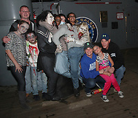 Adam Thurman, Ricky Cameron, Johnny McCarthy, Katelyn McCarthy, Jolene Williams, Mckayla Williams, Hailey Simpson, Ava Burke and Daniel Santugwana all came to take the Ghost Ship Harbor Haunted House tour aboard Quincy's USS Salem.  (Photo by Gary Wilcox)