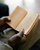 ERITREA, Asmara, the hands of Abdullah Omar holding the Koran at the Asmara Post Office