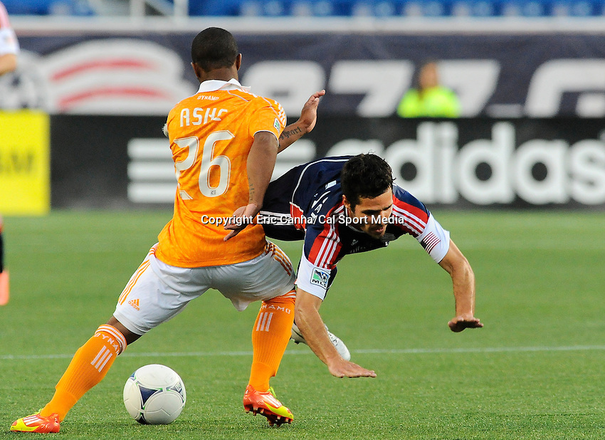 MAY 19 2012 New England Revolution midfielder Benny Feilhaber #22 gets tripped up by Houston Dynamo midfielder Corey Ashe #26...