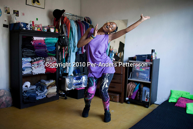 SOWETO, SOUTH AFRICA - MAY 7: Manthe Ribane, age 22, a dancer, trains at home on May 7, 2010, Soweto, South Africa. She will perform at the opening ceremony and other games during the FIFA World Cup held in South Africa between June 11 to July 11, 2010. A part time model, dancer and artist, she is one of the young black South Africans who has received more opportunities than their parents. In hosting the largest sporting event in the world, South Africa has a chance to impress the world with their country, hoping that the month long event will bring long lasting benefits for the country. (Photo by Per-Anders Pettersson)
