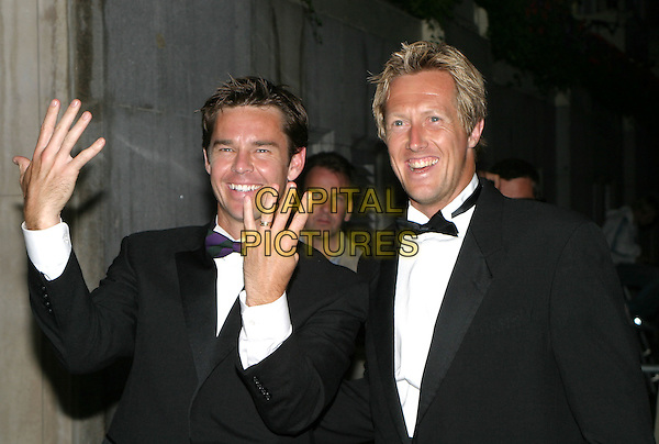 TODD WOODBRIDGE & JONAS BJORKMAN.Leaving the Wimbledon Champions dinner at the Savoy Hotel, London,.4th July 2004..portrait headshot fingers ring gesture .www.capitalpictures.com.sales@capitalpictures.com.©Capital Pictures
