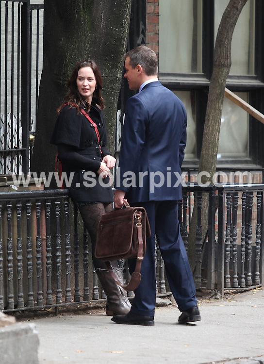 "**ALL ROUND PICTURES FROM SOLARPIX.COM**.**SYNDICATION RIGHTS FOR UK, AUSTRALIA, DENMARK, PORTUGAL, S. AFRICA, SPAIN & DUBAI (U.A.E) ONLY**.Filming of the film ""The Adjustment Bureau"" on Perry Street in Greenwich Village, New York City, NY, USA. 5 October 2009.This pic: Emily Blunt and Matt Damon..JOB REF: 10080 PHZ Mayer   DATE: 05_10_2009.**MUST CREDIT SOLARPIX.COM OR DOUBLE FEE WILL BE CHARGED**.**MUST NOTIFY SOLARPIX OF ONLINE USAGE**.**CALL US ON: +34 952 811 768 or LOW RATE FROM UK 0844 617 7637**"
