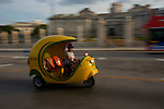 "The ""coco taxi"" isa good way to move fast and cheap in La Havana"