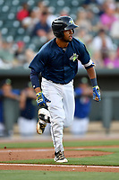 Second baseman Luis Carpio (18) of the Columbia Fireflies runs toward first in a game against  the West Virginia Power on Thursday, May 18, 2017, at Spirit Communications Park in Columbia, South Carolina. Columbia won in 10 innings, 3-2. (Tom Priddy/Four Seam Images)