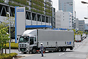 A Sagawa Express delivery truck drives past the Sagawa headquarters on July 28, 2017, Tokyo, Japan. Sagawa Express Co. expects to increase its delivery charges from November 21st due to the increasing demand from online shopping. The company said on Wednesday that its door to door service fee would rise 17.8 percent on average. Competitor Yamato Transport Co. also plans to raise rates in October. (Photo by Rodrigo Reyes Marin/AFLO)