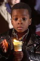 Malcom Scott, 5, holds a candle during the candlelight vigil at the Martin Luther King Jr. Memorial Plaza. .Tuesday night,.\fp\\b0\\i0\\fs10\--------------------------------.\fp\\i0\\b\\fs16\Copyright 2000 Pensacola News Journal..\fp\\b0\\i0\\fs10\Copyright=Yes; Year=2000; Month=12; Month=Dec; Day=12; Day=Tu; Photographer=Michael_Spooneybarger; ..Aspect=Local:Staff; Aspect=12.12.2000; Aspect=Color; Aspect=Yes; Aspect=2000; Aspect=12; Aspect=Dec; Aspect=12; Aspect=Tu; Aspect=Michael_Spooneybarger;