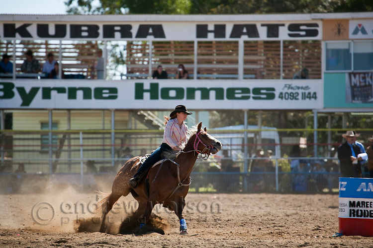 Cowgirl competing in barrel race at the Mareeba Rodeo.  Mareeba, Queensland, Australia