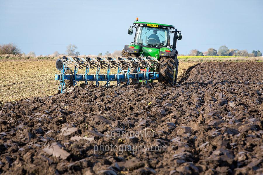 Lemken nine furrow plough and John Deere ploughing ex sugar beet land - Lincolnshire, October