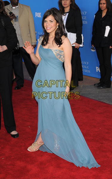 AMERICA FERRERA .Attends The 39th NAACP Image Awards held at The Shrine Auditorium in Los Angeles, California, USA..February 14th, 2008        .full length blue dress hand palm waving  gold detail sheer .CAP/DVS.©Debbie VanStory/Capital Pictures.