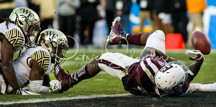 Photography coverage of the 2017 Belk Bowl game between the Wake Forest Demon Deacons and the Texas A&M Aggies at Bank of America Stadium in Charlotte, North Carolina.<br /> <br /> Charlotte Photographer - PatrickSchneiderPhoto.com